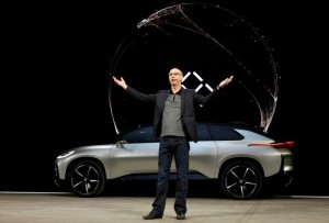 Nick Sampson, senior vice president of product R&D and engineering at Faraday Future, speaks in front of a Faraday Future FF 91 electric car during an unveiling event at CES in Las Vegas, Nevada January 3, 2017. REUTERS/Steve Marcus